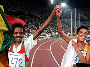 Derartu Tulu and Elana Meyer celebrate at the 1992 Olympics