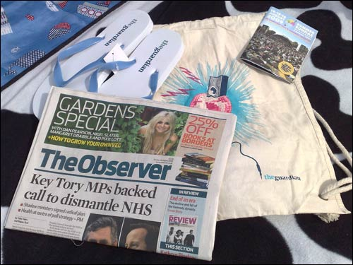 The Observer surrounded by Guardian branded freebies