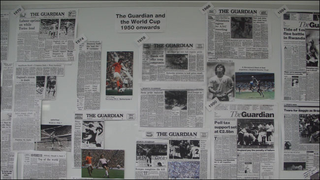 A close-up of the print outs from the Manchester Guardian and Guardian archives