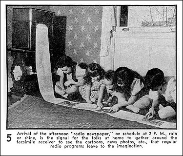 A newspaper radio facsimilie being read by a group of children