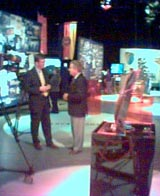 Nick Higham does a piece to camera with Richard Baker in the News 50 exhibition
