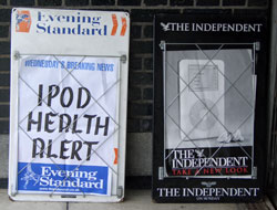 Evening Standard and The Independent billboards together - one claiming 'IPOD HEALTH SCARE', the other using the iPod in its' marketing imagery