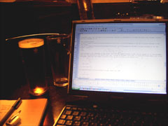 Beer and laptop, blogging at The College Arms