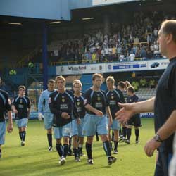 A victorious Leeds United team leaves the QPR pitch