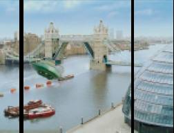 A very bad still of Thunderbird 2 approaching Tower Bridge