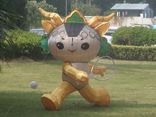 An Olympic mascot plays tennis
