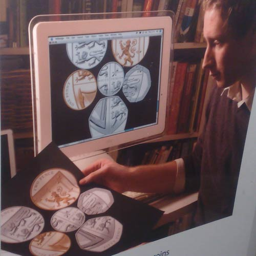 Matt Dent and his coins displayed on Indesign