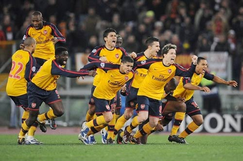 Arsenal celebrate their penalty shoot-out victory over Roma