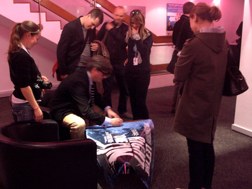Tomas Alfredson signing a film poster for the Barbican
