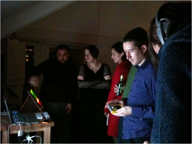 People gather to play with Jason's gadgets at London IA