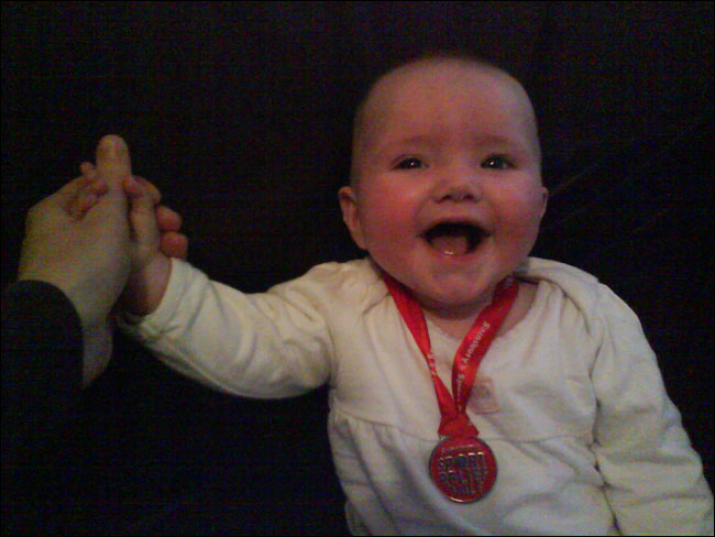 Emma with her Sport Relief medal
