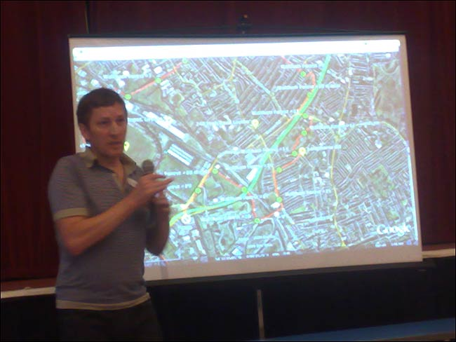 Simon Pope and the route map behind him